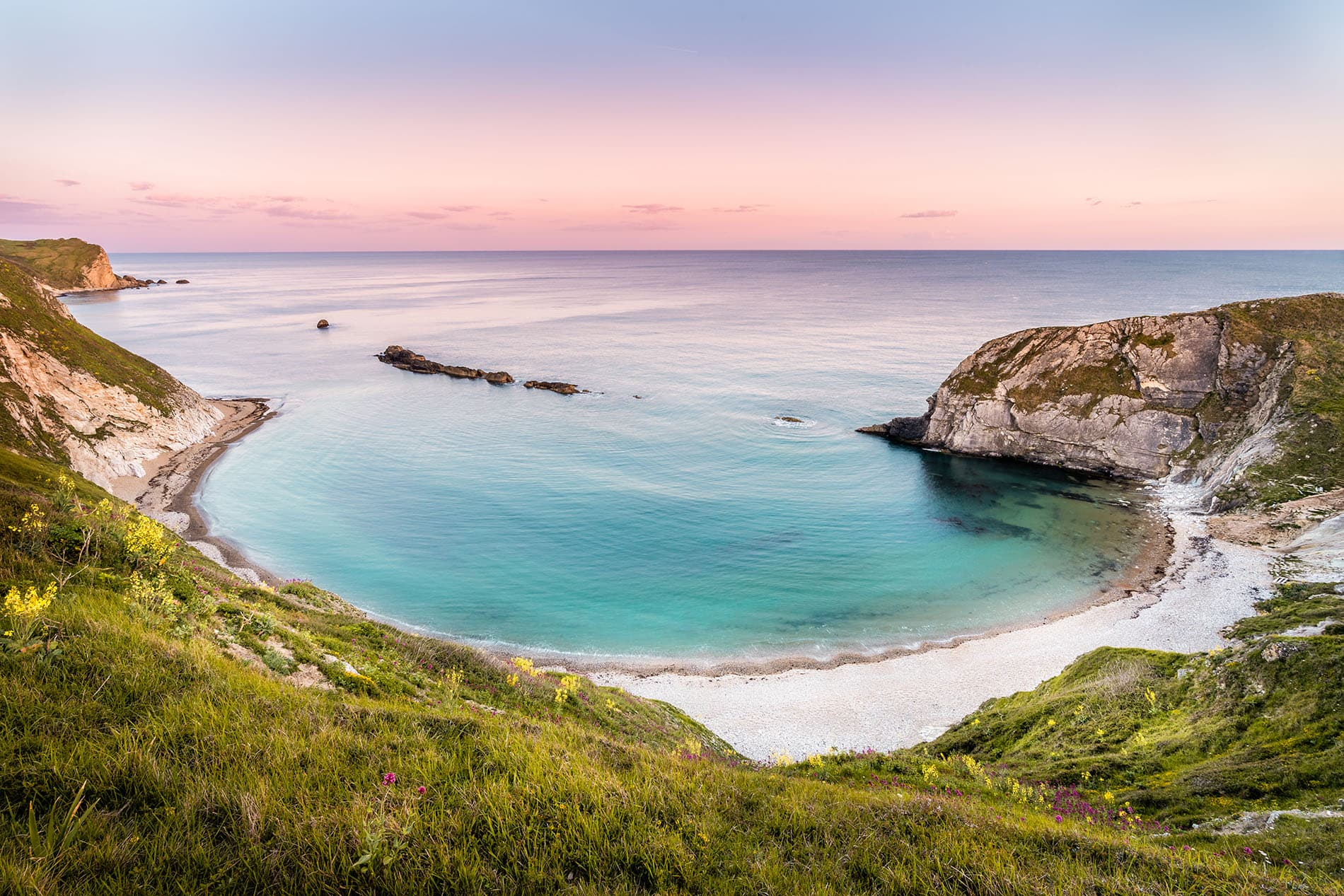 lulworth cove in dorset landscape photo at sunset
