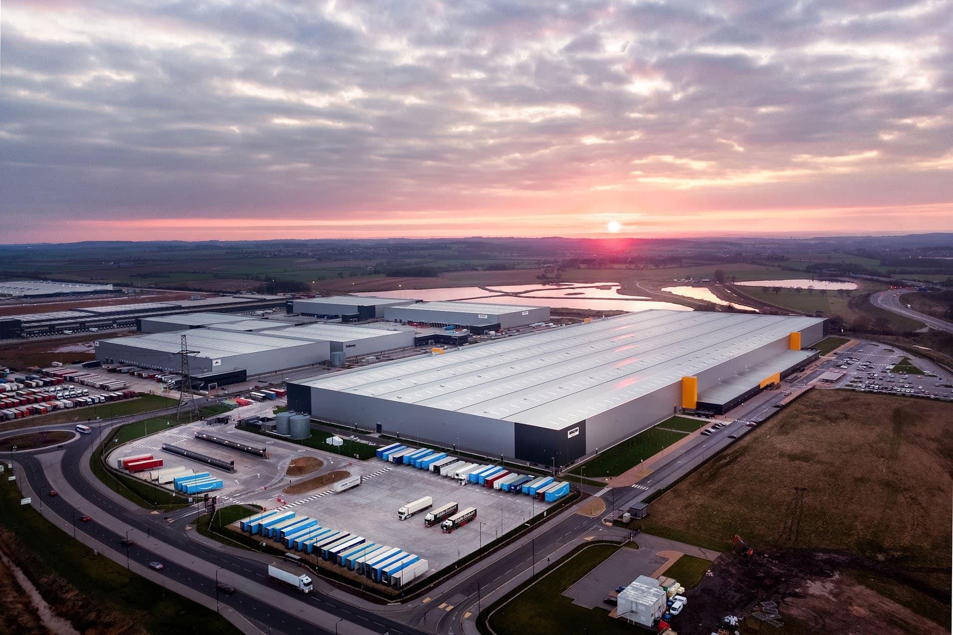 drone photo of amazon warehouse